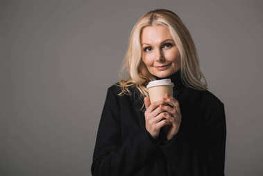 woman with disposable cup of coffee