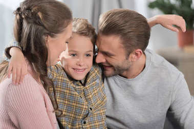 Smiling parents with son