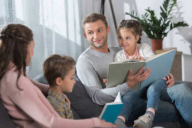 kids and parents reading books