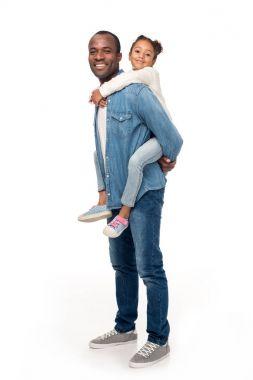 father piggybacking daughter