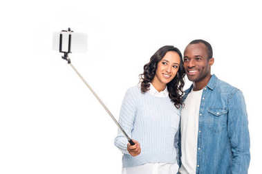 african american couple taking selfie