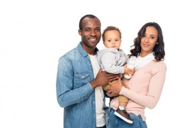 Happy african american parents carrying cute little son and smiling at camera isolated on white stock vector