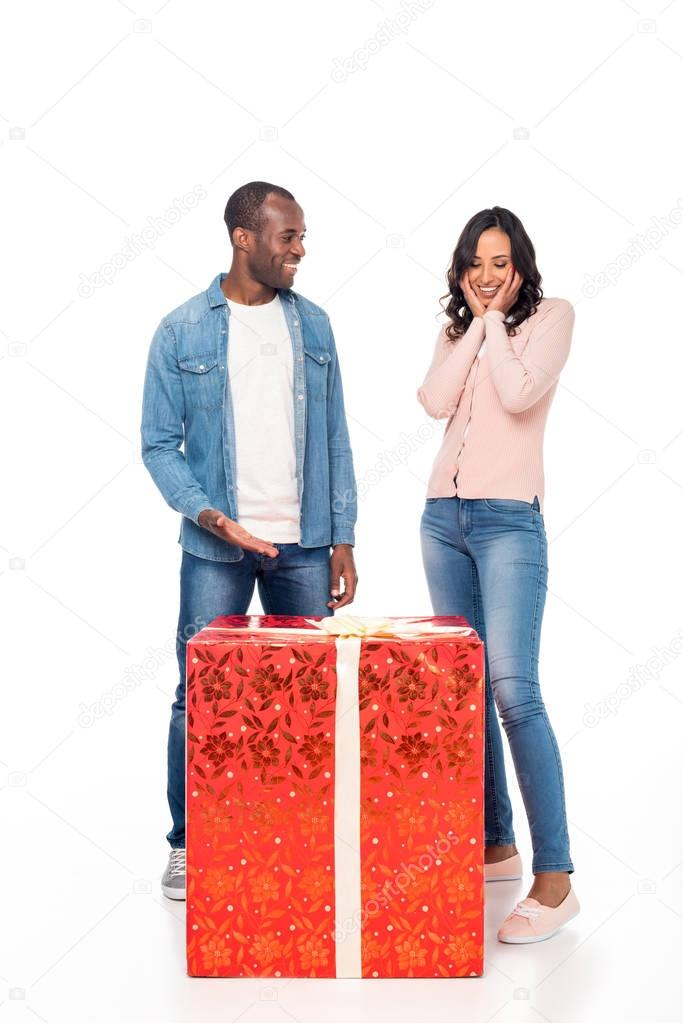 african american couple with gift