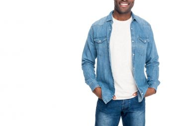 Cropped shot of smiling african american man standing with hands in pockets isolated on white stock vector