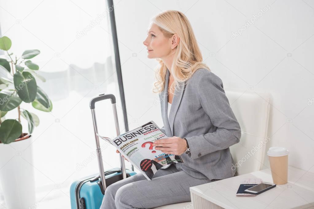 mature businesswoman with magazine