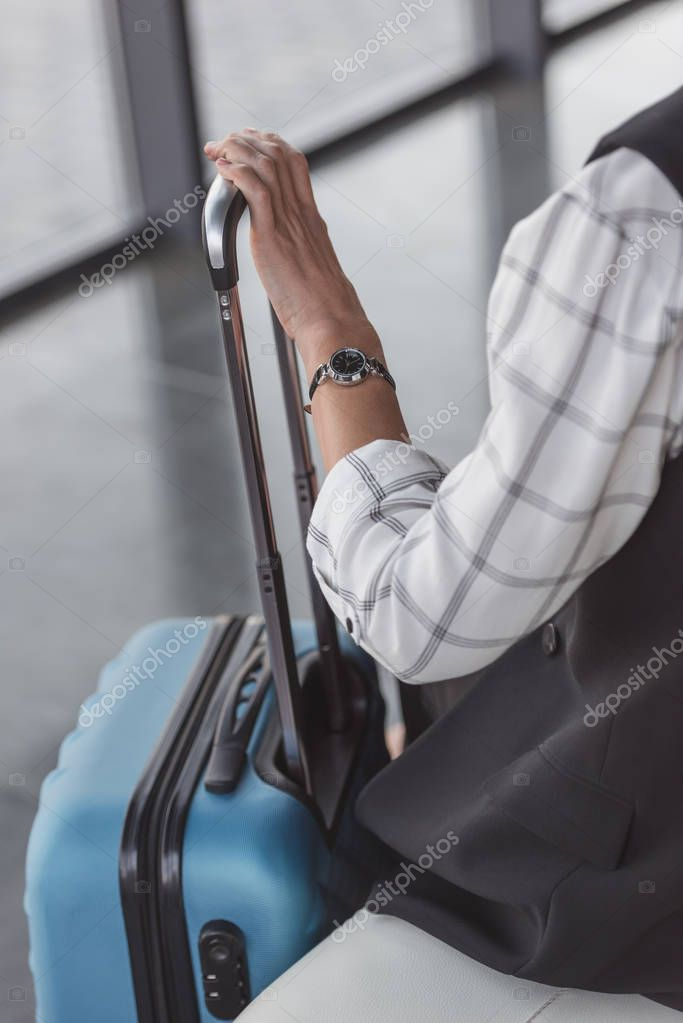 stylish woman with suitcase