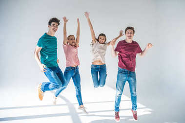 young people jumping together