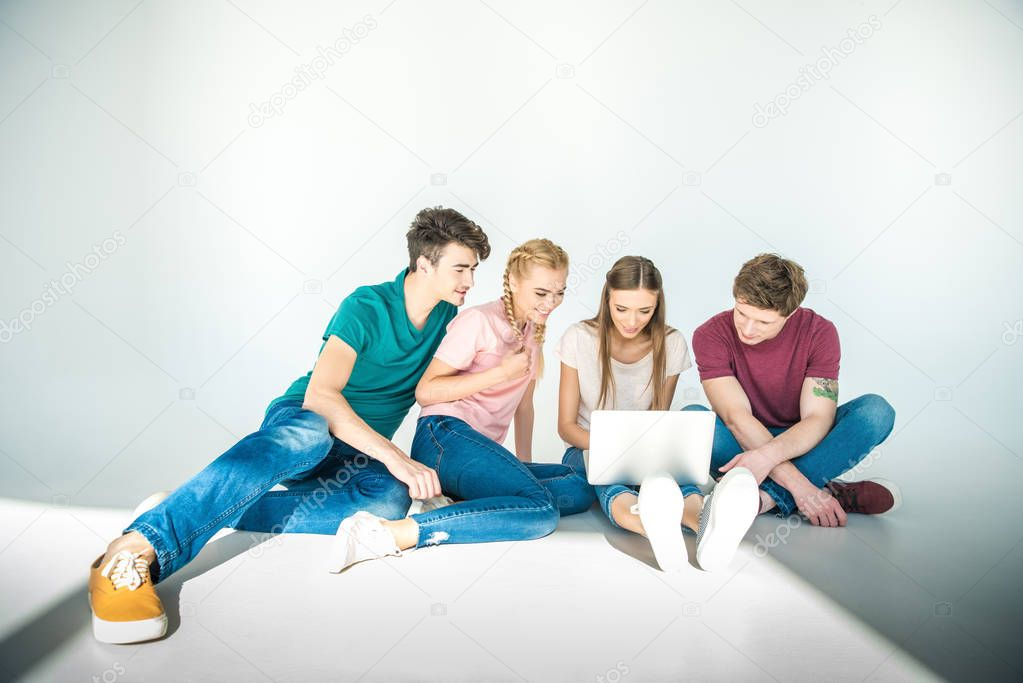 young friends using laptop