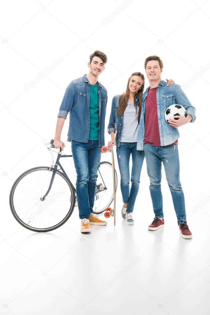 young friends with sport equipment