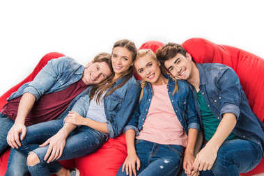 friends sitting on bean bag chairs