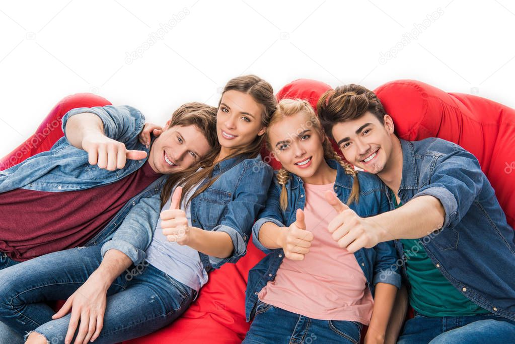 friends showing thumbs up