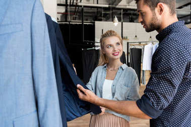 couple choosing male clothes