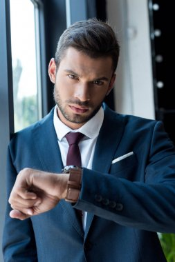 businessman checking wristwatch