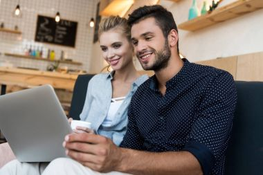 couple with digital tablet in cafe