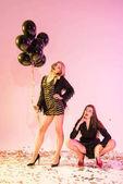 glamorous girls with black balloons
