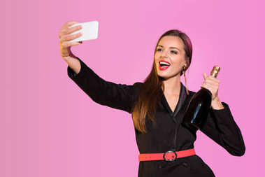 happy woman with champagne taking selfie