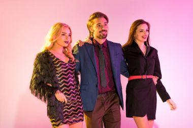 stylish man with two glamorous girls