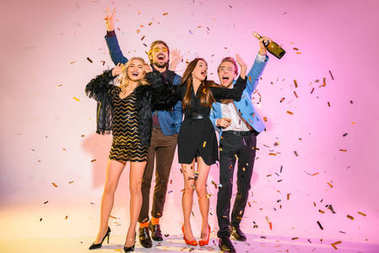 friends on party with confetti