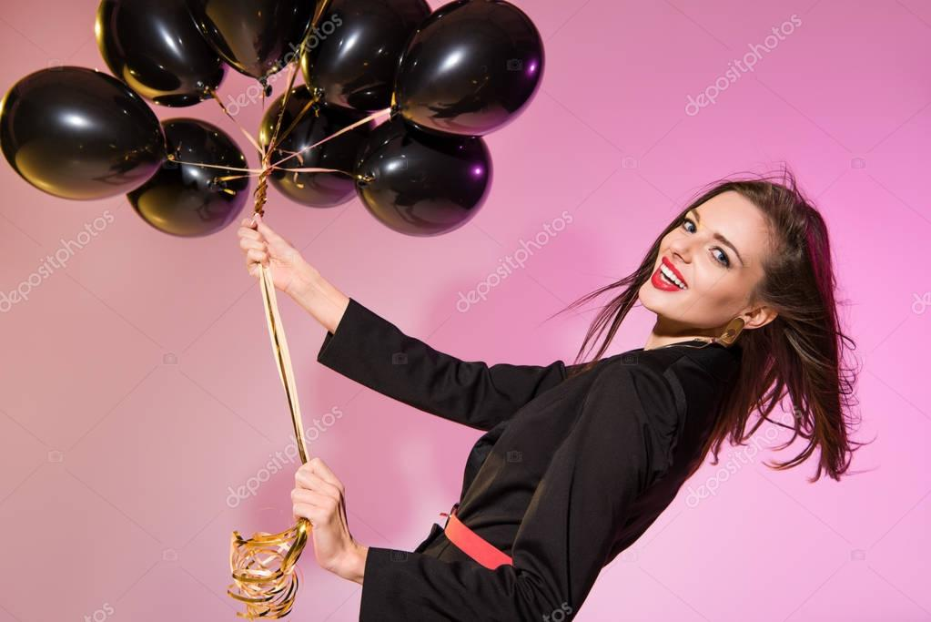 smiling woman with balloons