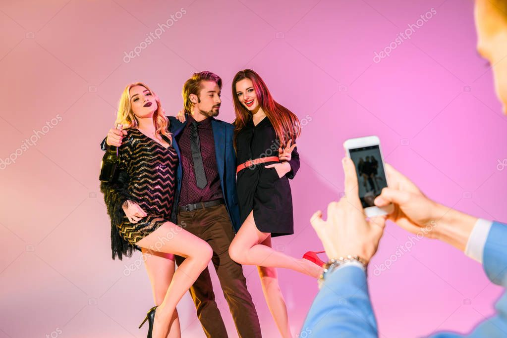 taking photo of man with girls