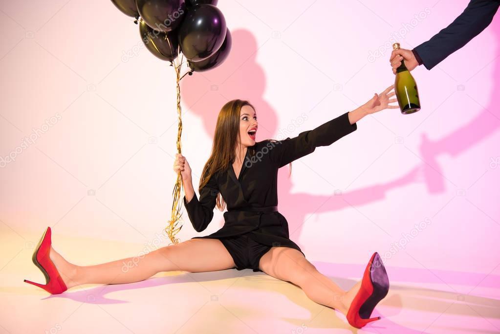 glamorous girl with black balloons