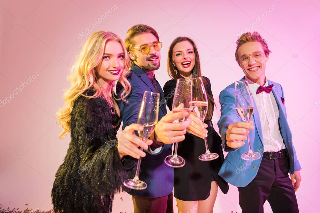 friends clinking with champagne on party