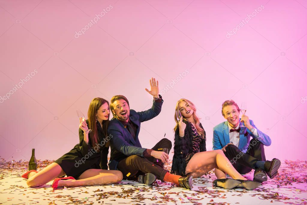 friends sitting on floor with confetti