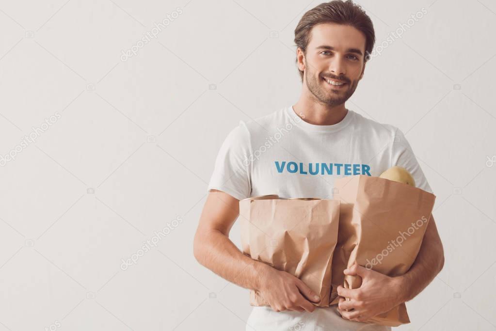 volunteer with paper bags
