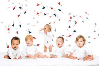Group of cute multiethnic toddlerboys and girls isolated on white stock vector