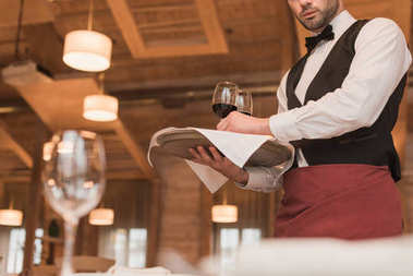 waiter holding tray with wineglasses
