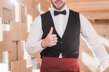 waiter showing thumb up