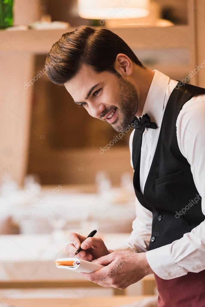 waiter writing down the order