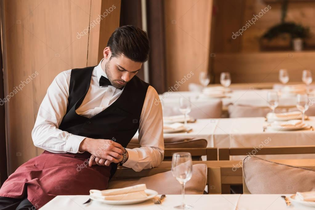 Waiter looking at watch