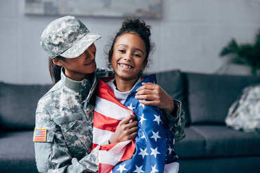 African american daughter wrapped with american flag and female soldier in military uniform stock vector