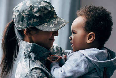 mother in military uniform with little son