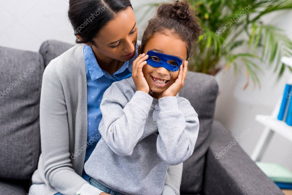mother and daughter in superhero mask
