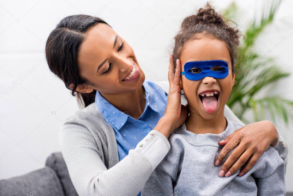 daughter in superhero mask