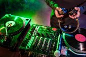 Fotografie DJ with headphones over sound mixer