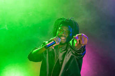 DJ with microphone in nightclub