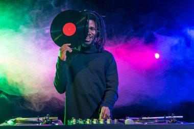 african american DJ with vinyl