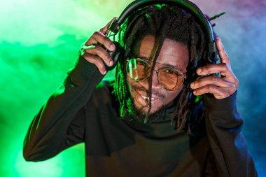 DJ in headphones and sunglasses