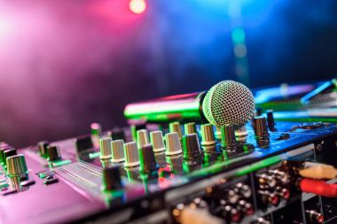 Close up view of sound mixer with microphone in nightclub stock vector