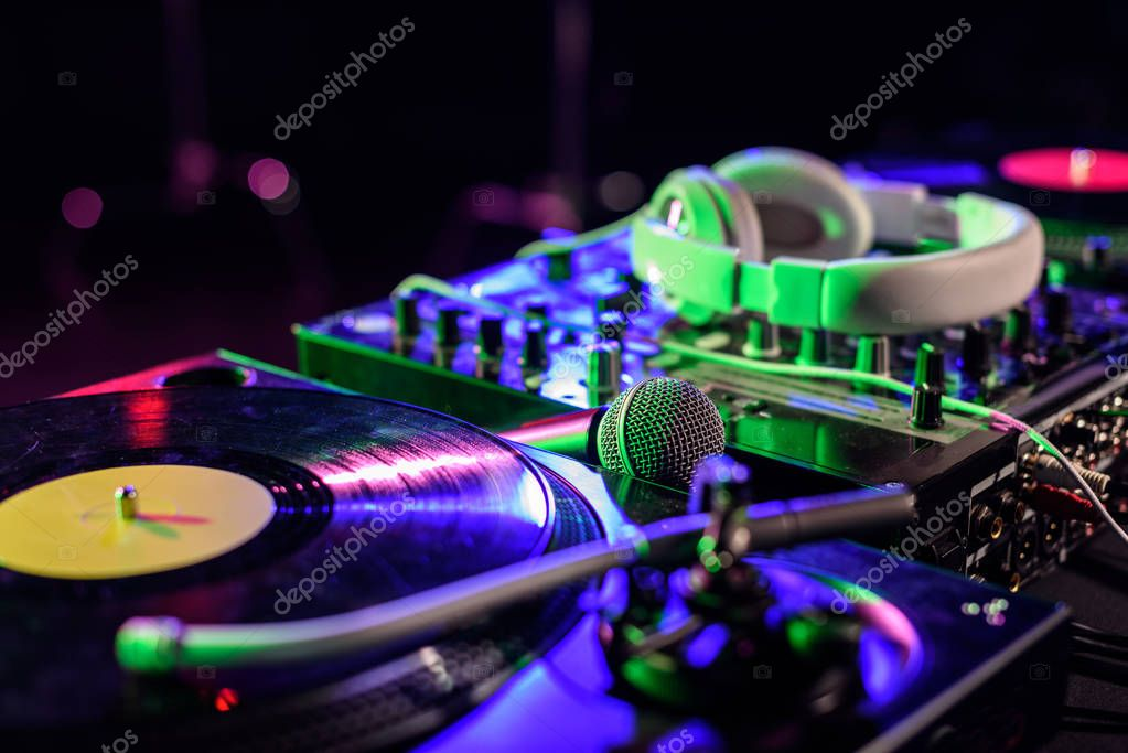 vinyl, microphone and headphones