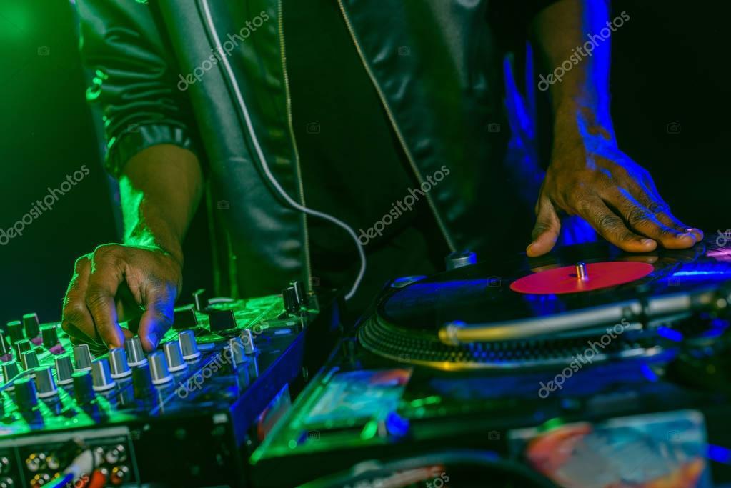 DJ with sound mixer and vinyl