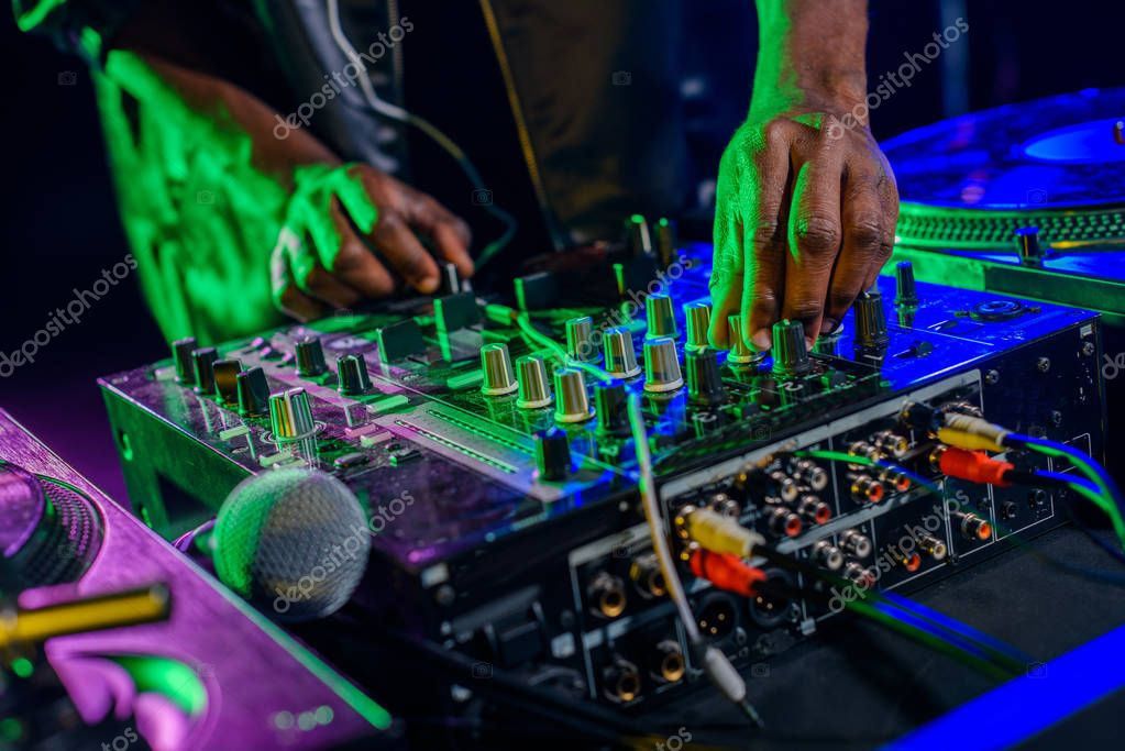 DJ in with sound mixer