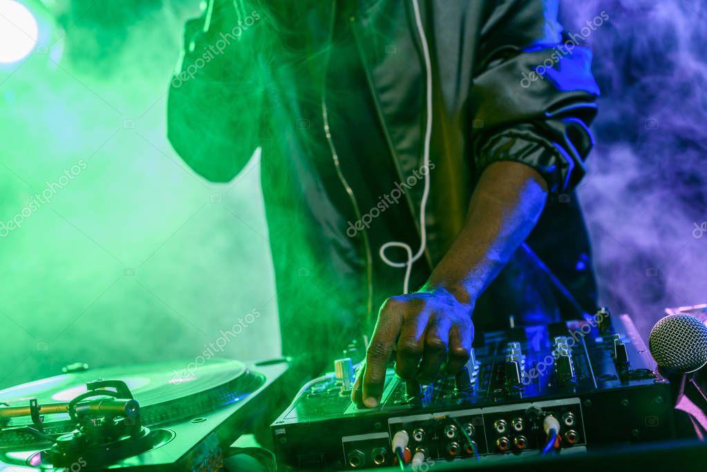 DJ with sound mixer on concert