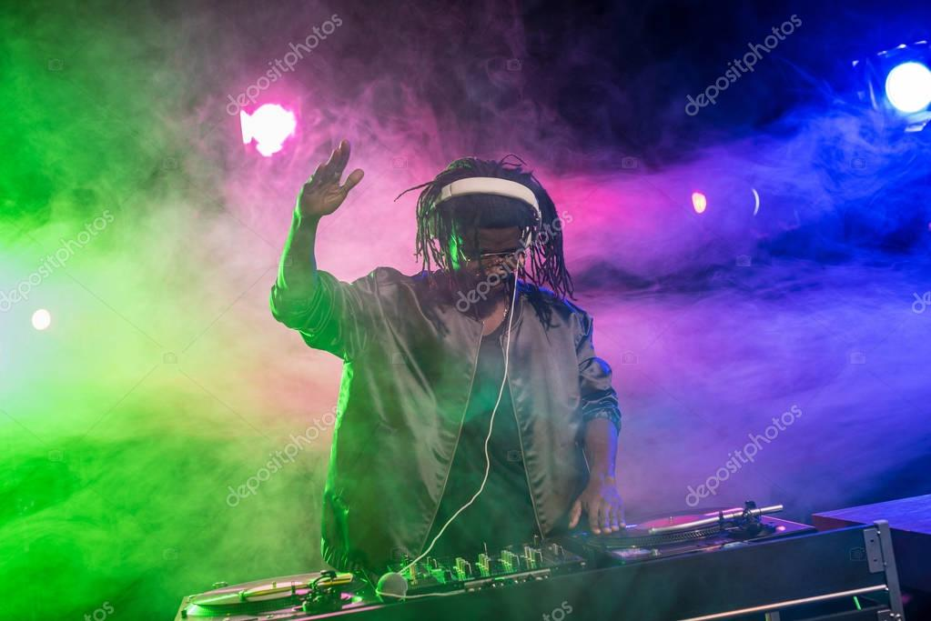 african american DJ with sound mixer