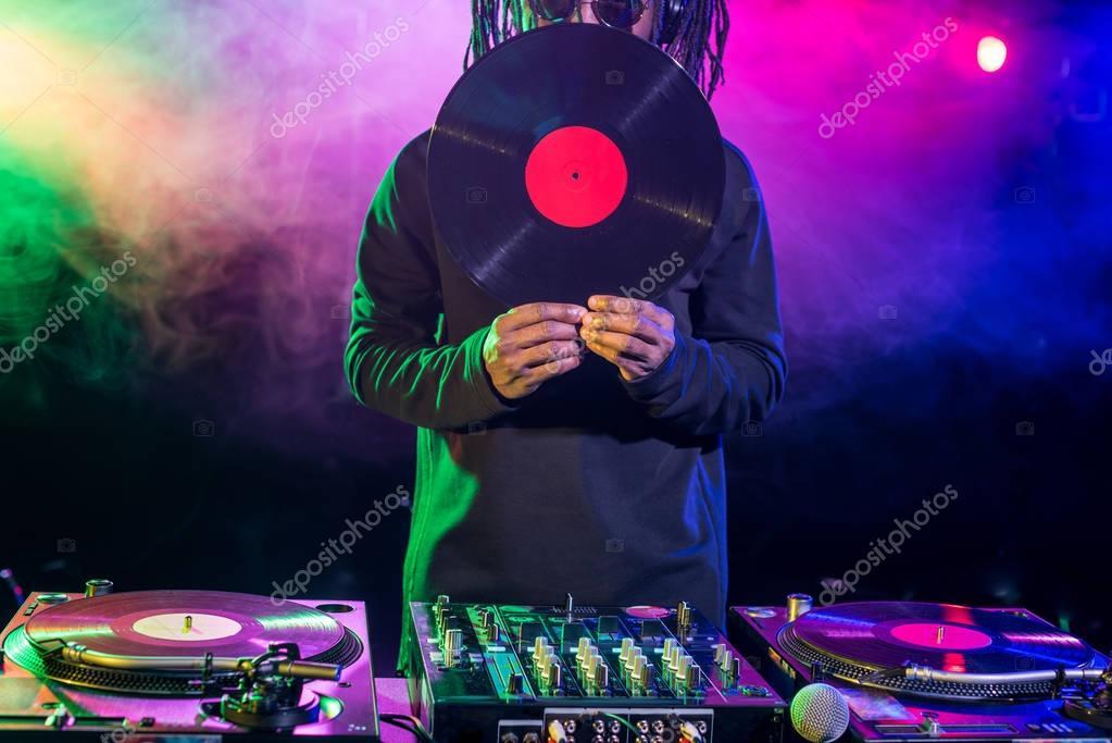 DJ with vinyl and sound mixer