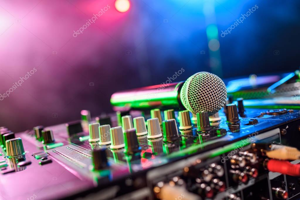 sound mixer with microphone in nightclub