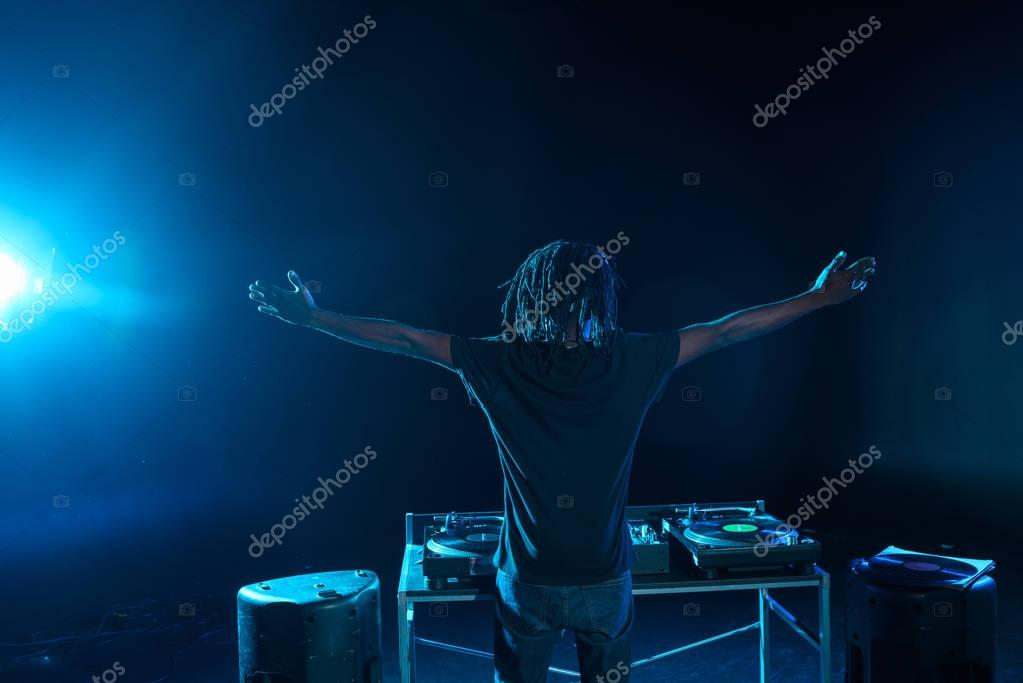 DJ with sound mixer